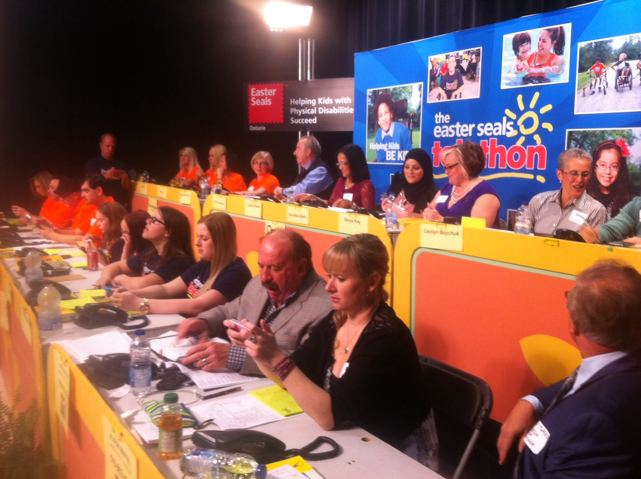 Panelists take calls during the 31st annual Easter Seals Telethon, April 13, 2014. (Photo by Adelle Loiselle)