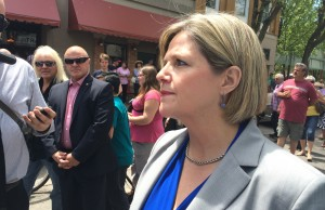 Ontario NDP Leader Andrea Horwath answer reporter questions while campaigning at Chatham's RetroFest on May 24, 2014. (Photo by Ricardo Veneza)