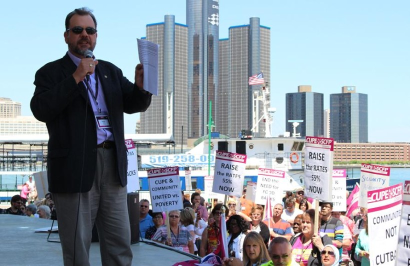 CUPE Local 543 Second Vice President Patrick Hannan speaks at a rally, May 30, 2014, at Windsor's Riverfront Festival Plaza.