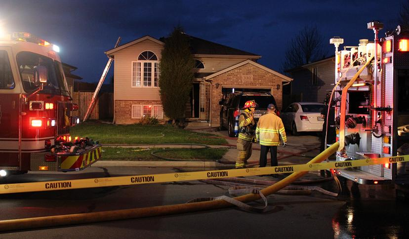 Windsor fire crews respond to a blaze at 3312 Conservation Dr., May 1, 2014. (Photo by Mike Vlasveld)