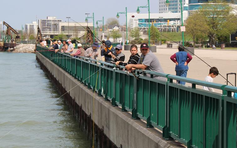 A crowd fishing along the Detroit River at the foot of Ouellette Ave. downtown Windsor.