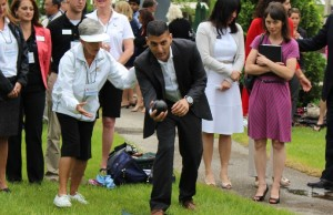 Windsor Mayor Eddie Francis tries his hand at lawn bowl at the kickoff to the 2014 Ontario 55+ Summer Games countdown. (Photo by Maureen Revait)