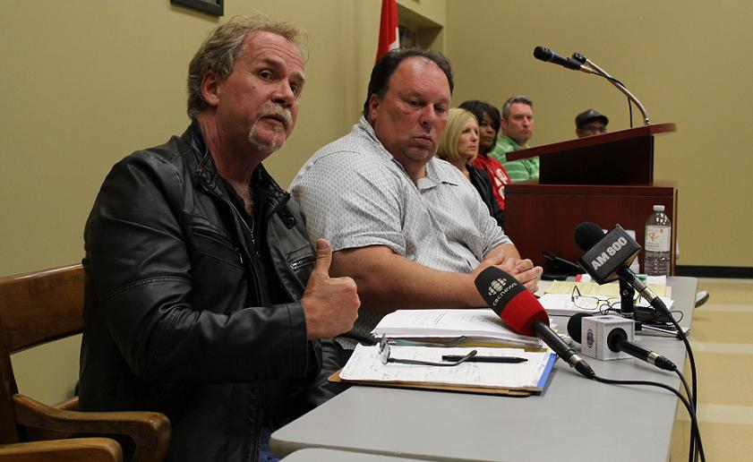 Unifor Local 195 President Gerry Farnham and Union Staff Representative Mike Renaud speak to union members