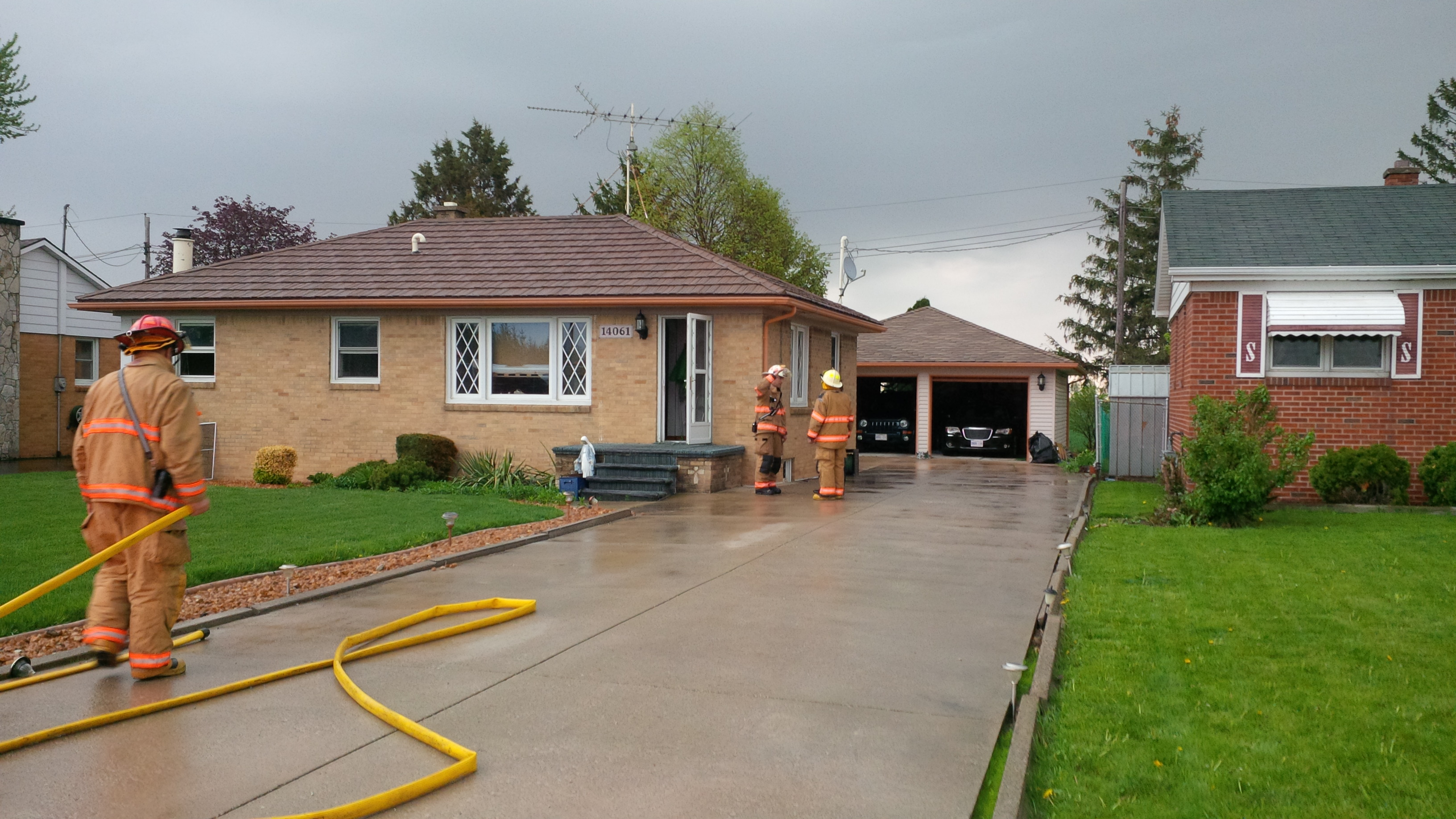 Essex fire crews responding to a fire at 14061 Walker Rd. on May 12, 2014. (Photo by Ricardo Veneza)