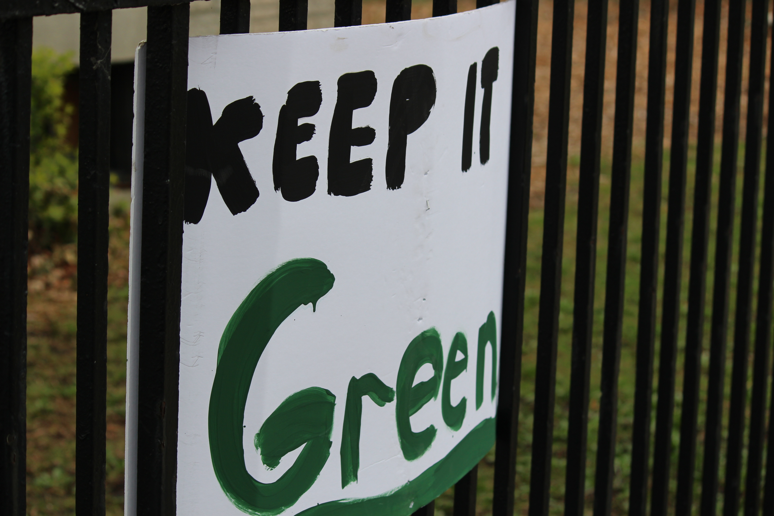 Protest signs hung up along one of the fences at Willistead Park in Windsor on May 3, 2014. (Photo by Ricardo Veneza)