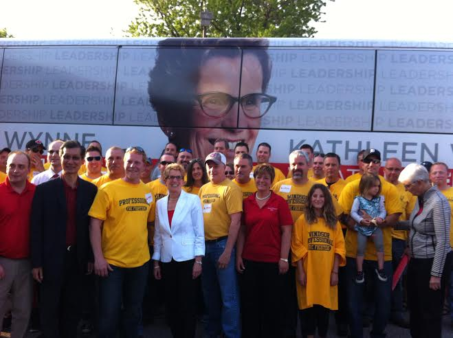 Liberal leader Kathleen Wynne with firefighters. May 20, 2014 (Photo by Ashton Patis)