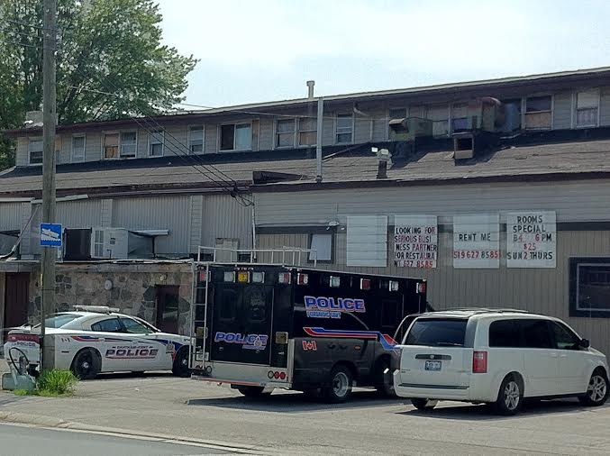 Forensics on scene at a Dufferin Ave. hotel in Wallaceburg, May 21, 2014. (Photo by Ashton Patis.)