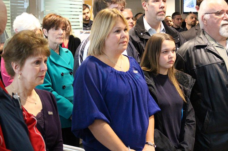 Constable John Atkinson's wife Shelley stands among family and friends at a memorial service at Windsor police headquarters, May 5, 2014. (Photo by Mike Vlasveld)