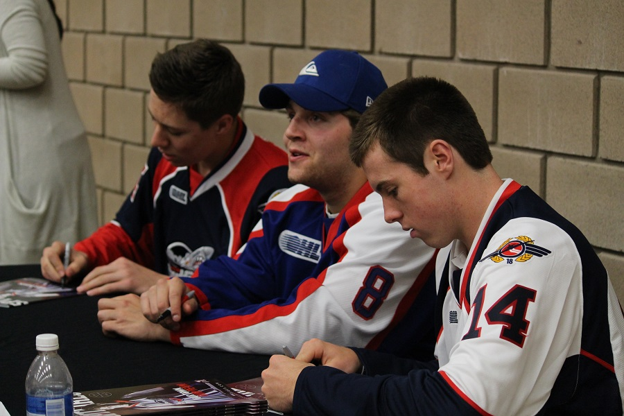 Windsor Spitfires draft pick Logan Stanley, player Trevor Murphy, and draft pick Blake Coffey