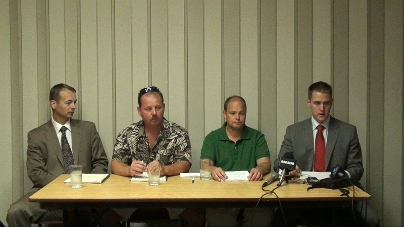 From left to right: Lawyer Rob Talach, victims David Turrill and Denis Robert, and Lawyer Aaron Lealess at a news conference in August 2011. (Dave Richie, BlackburnNews.com)
