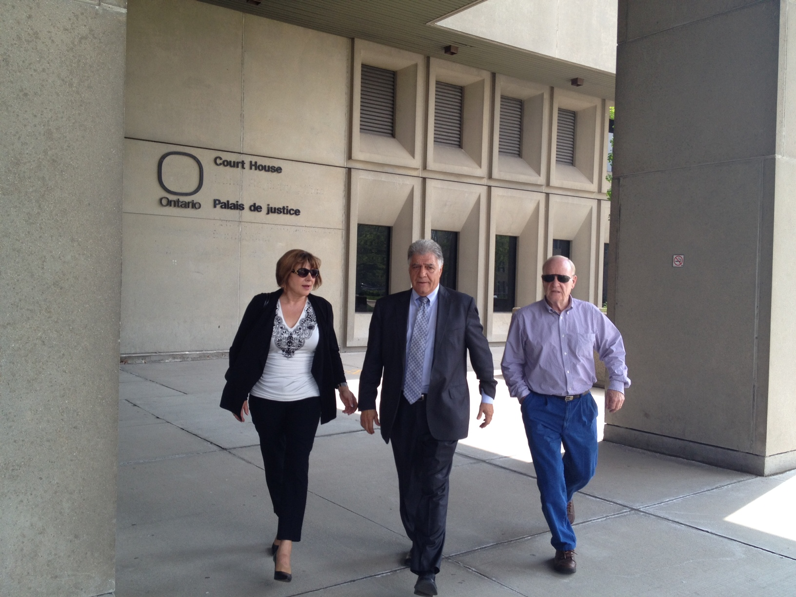 Joe Fontana, his wife Vicky and another man leave the courthouse after the second day of the mayor's trial.