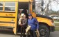 Sacred Heart Students in Wingham load donated food into school bus, April 2014. BlackburnNews.com photo