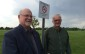 Leamington Mayor John Paterson (L) and Councillor Rick Atkin stand by a sign put up at the Leamington Soccer Complex as a result of Leamington's smoke-free outdoor space bylaw. Photo taken May 27, 2014. (Photo by Ricardo Veneza)