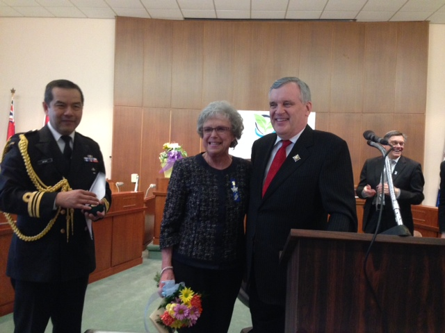 Wilma McNeil is presented with the Lieutenant Governor's Community Volunteer Pin at Sarnia's 100th Birthday Celebration May 7, 2014 BlackburnNews.com (Photo by Melanie Irwin)