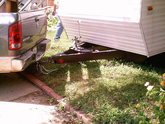 trailer hitch hooked up to a camper