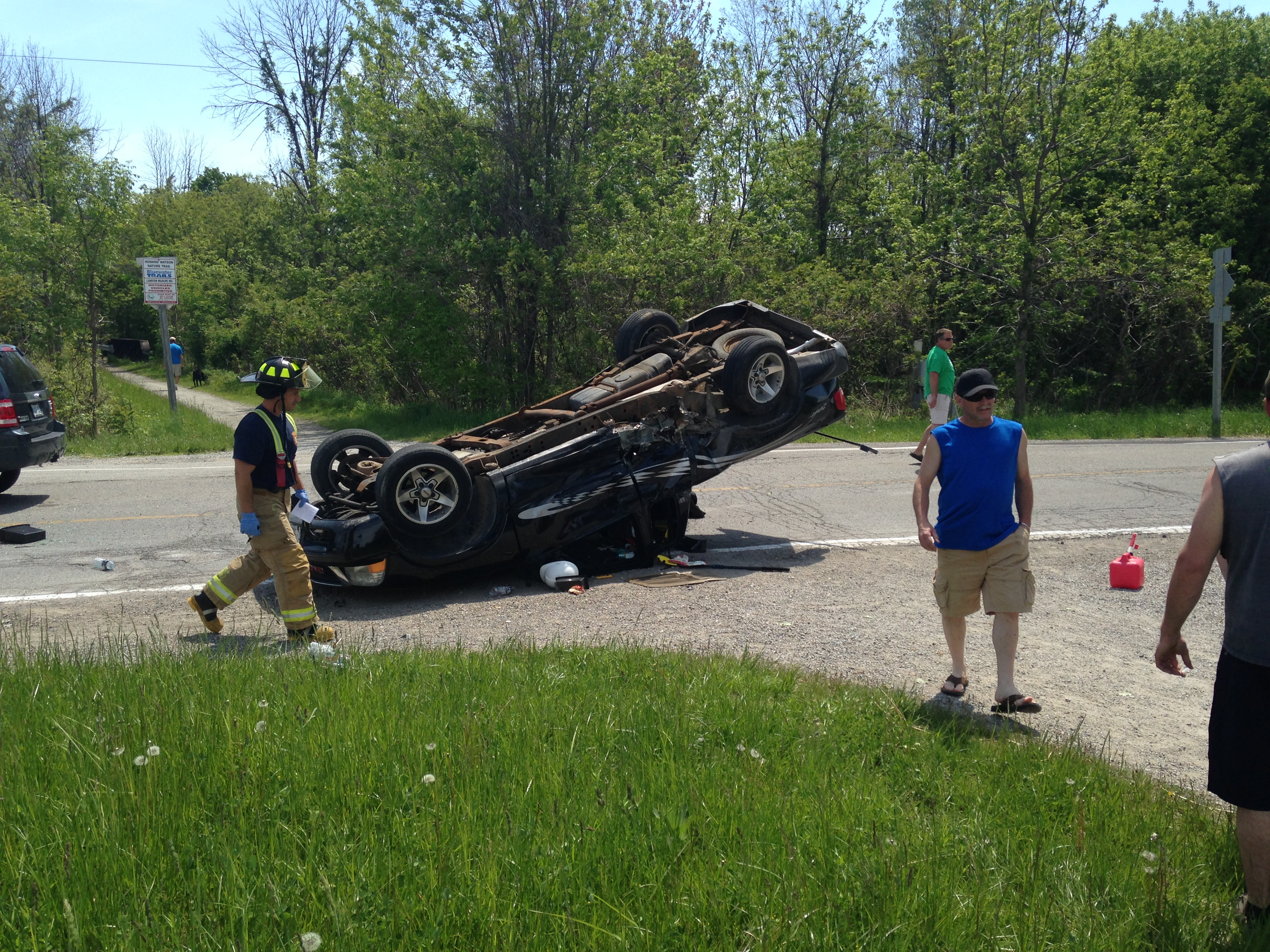Police, EMS and fire crews attend the scene of a three-vehicle crash in the area of Lakeshore Rd. and Waterworks Side Rd. in Brights Grove, June 1, 2014. (Photo courtesy of Brian Grahlman)