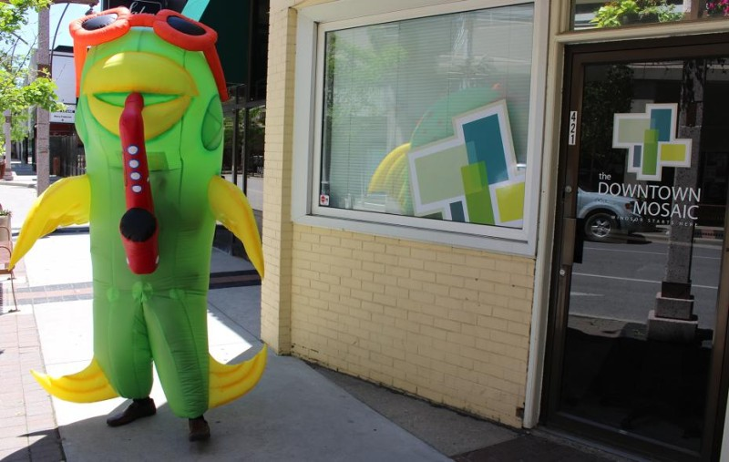 A man in a blow-up fish costume promotes Balloonapalooza on Pelissier St. in Windsor, June 5, 2014.