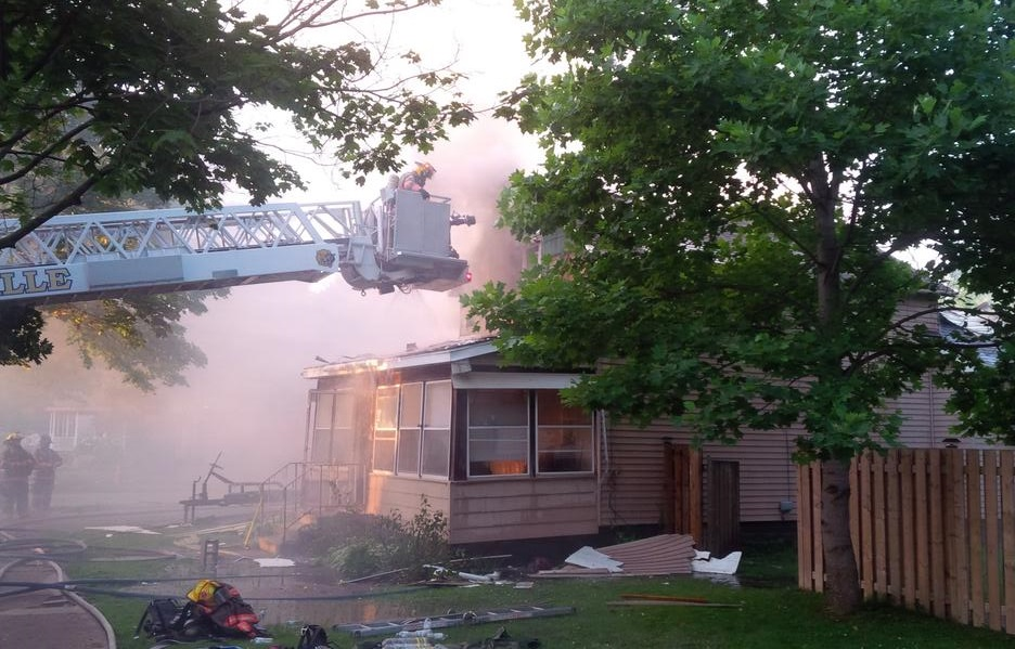 Firefighters respond to a house fire on Queen St. in Kingsville, June 26, 2014. (Photo courtesy of the Kingsville Fire Department)