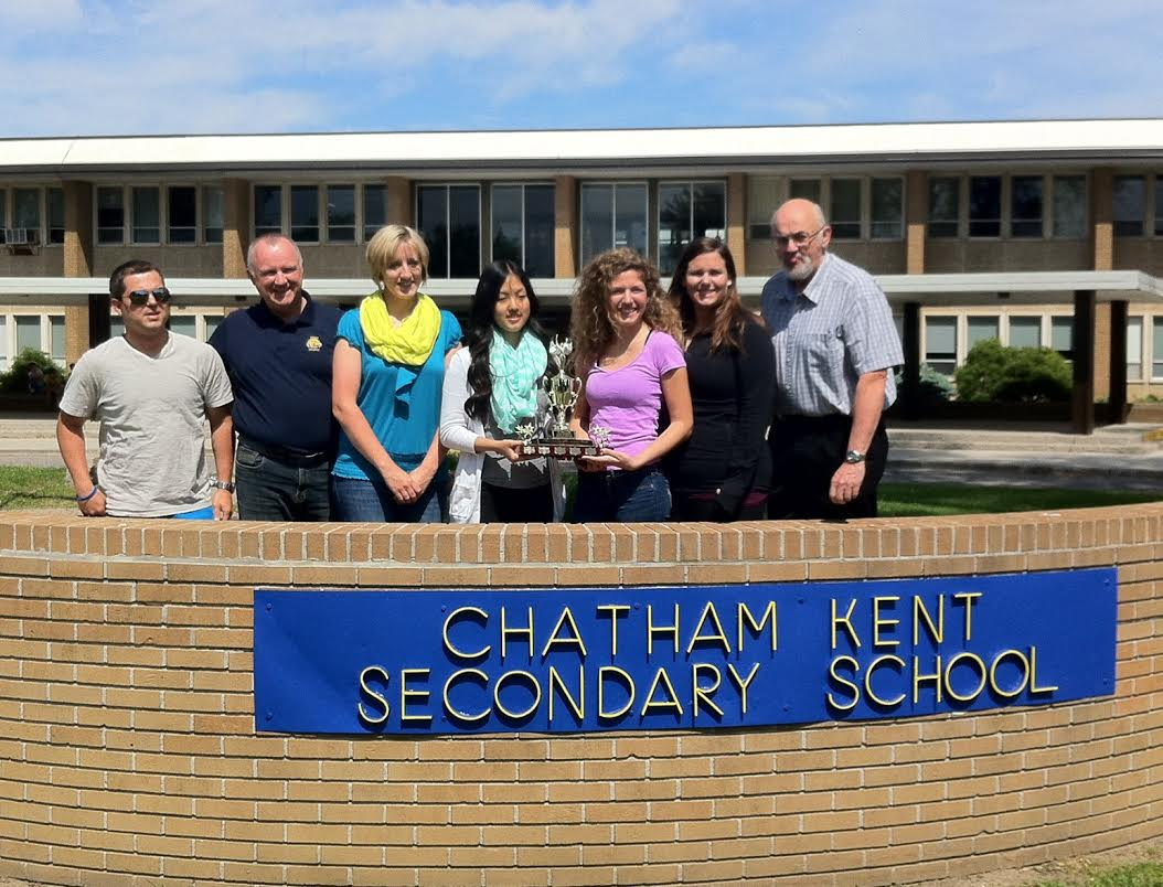 Chatham-Kent Secondary School students pose with the Heart and Stroke Big Bike fundraising trophy outside the school. June 6, 2014. (Photo by Ashton Patis)