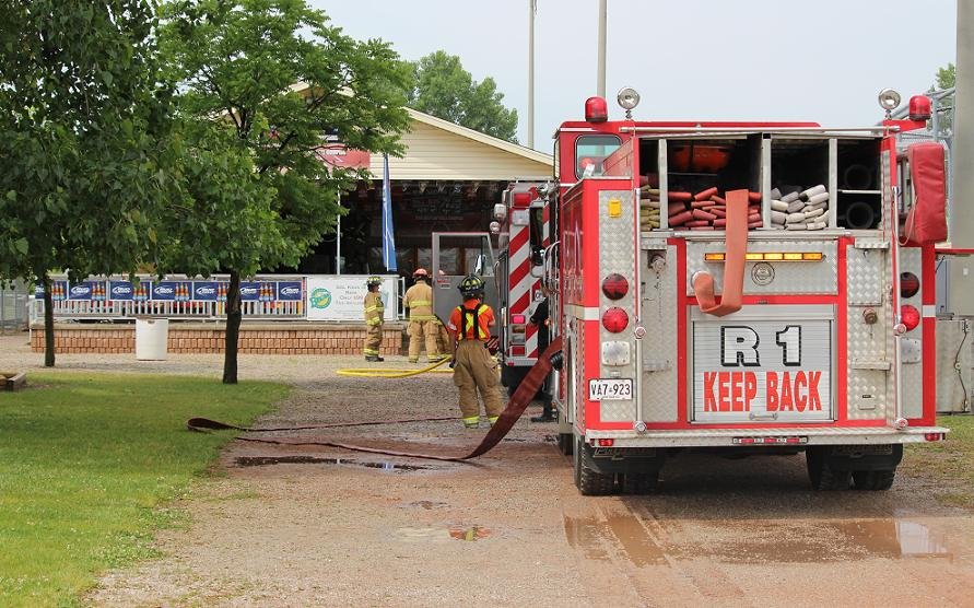 Tecumseh firefighters attend to a blaze at a field house behind the Ciociaro Club. June 18, 2014. (photo by Mike Vlasveld)