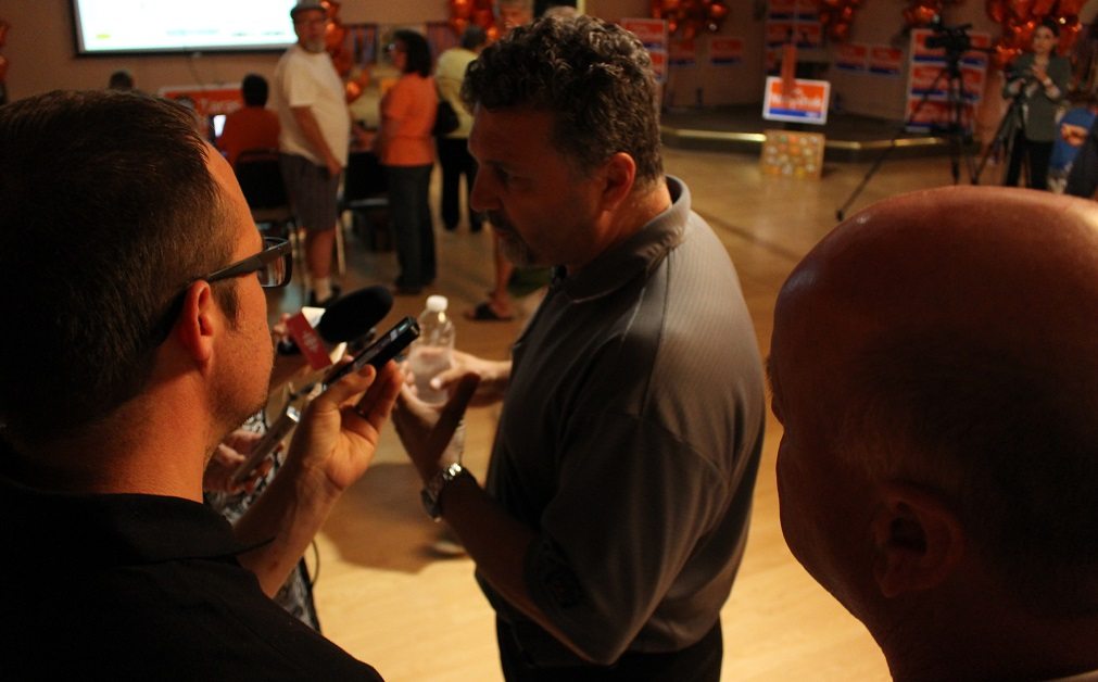 Unifor Local 444 President Dino Chiodo speaks to the media at Taras Natyshak's election victory party, June 12, 2014. (photo by Mike Vlasveld)