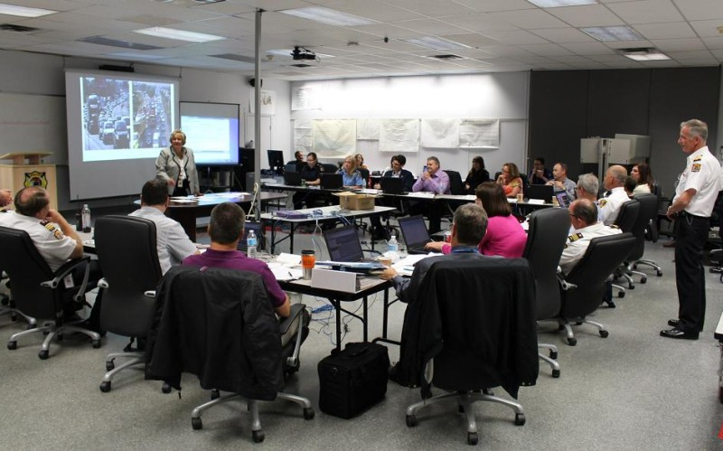 Windsor CAO Helga Reidel takes feedback from multiple departments across the city during an emergency training exercise at the Emergency Operations Centre, June 11, 2014. (photo by Mike Vlasveld)