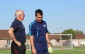 Windsor Stars Head Coach Steve Vagnini (R) speaks with Windsor Stars Technical Director Pat McNelis at a team practice on June 3, 2014. (Photo by Ricardo Veneza)