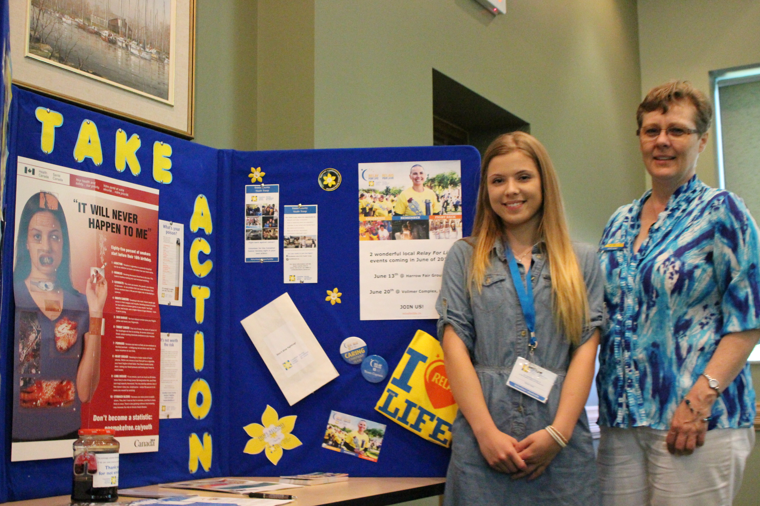 Youth volunteer Samantha Girard (L) and Manager Judy Lund with the Canadian Cancer Society Windsor-Essex branch at an information session in Tecumseh on June 3, 2014. (Photo by Ricardo Veneza)