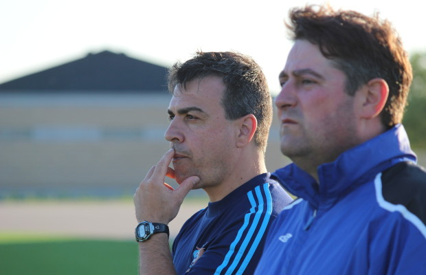 Windsor Stars Head Coach Steve Vagnini (furthest) and Goalie Coach Eddie Krusarovski watch on at a team practice on June 3, 2014. (Photo by Ricardo Veneza)