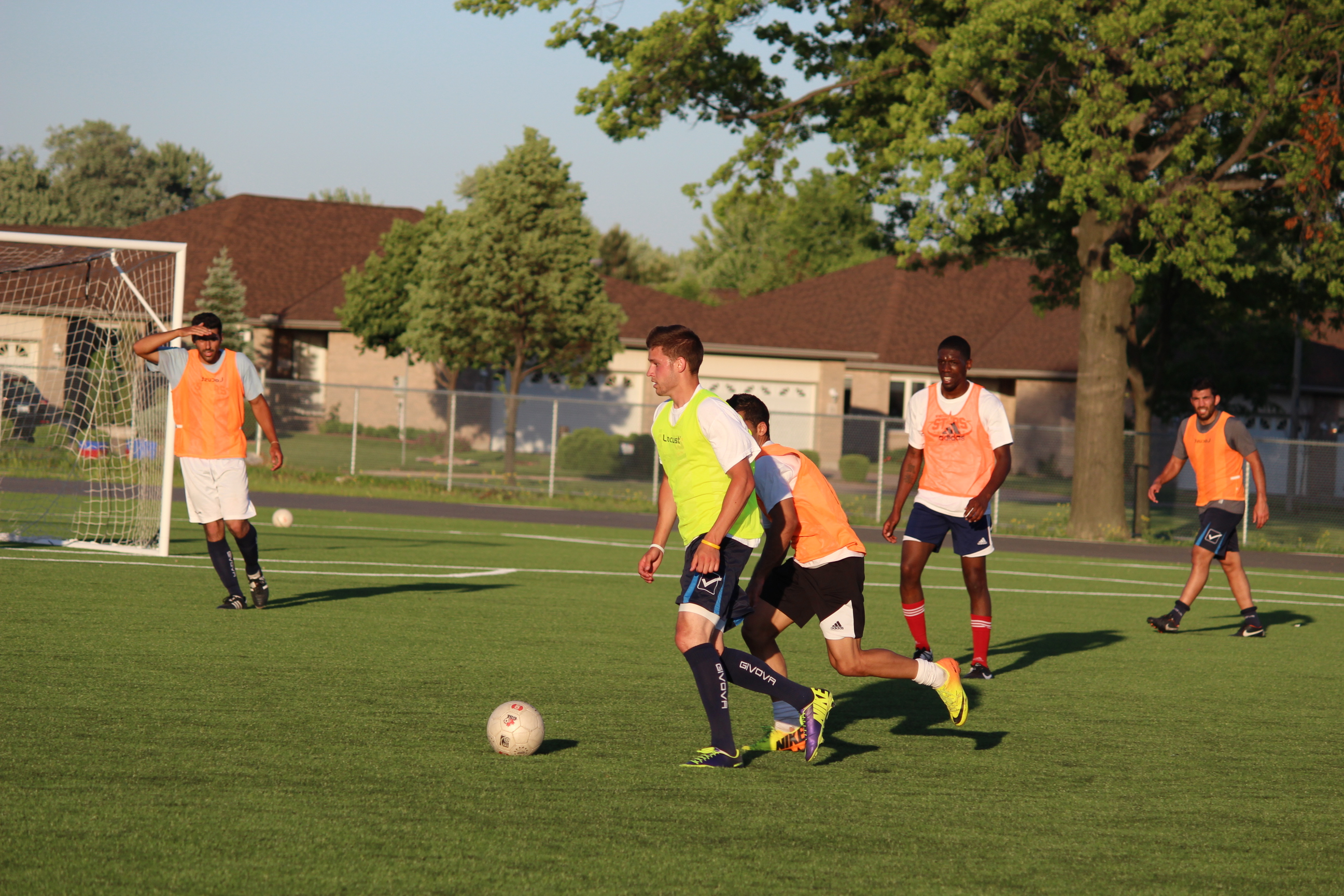 Windsor Stars striker Mike Pio takes the ball past a defender at a team practice at Academy Ste. Cecile in Windsor's west end on June 3, 2014. (Photo by Ricardo Veneza)