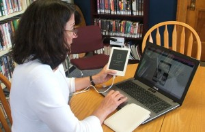 Meaford Public Library's adult programs co-ordinator Lori Ledingham is shown downloading an e-book. Photo by James Armstrong