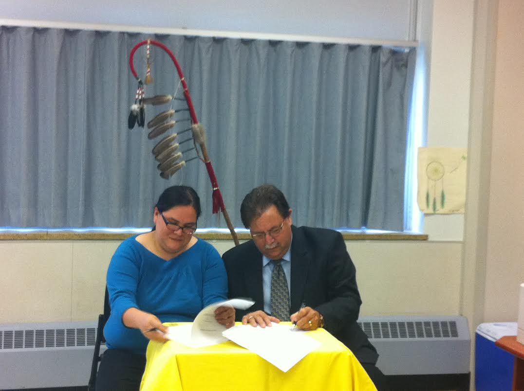 LKDSB Board Chair Scott McKinlay and Walpole Island Board Chair Leela Thomas sign the 2012-2017 First Nations tuition agreement. June 11, 2014. Photo by Ashton Patis.