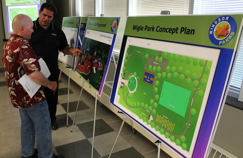 City of Windsor officials explain to residents the plans for renovations at Wigle Park during a public meeting, June 17, 2014. (photo by Mike Vlasveld)