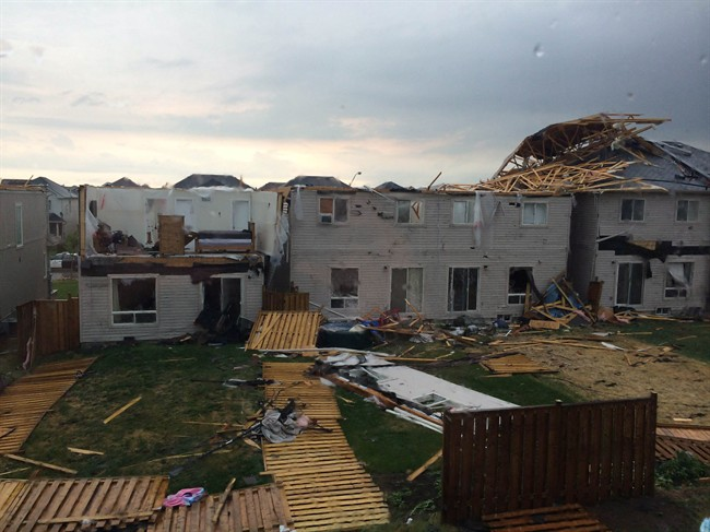 The backyards of homes in Angus, Ontario are shown on Tuesday June 17, 2014. Provincial police say there are reports of some minor injuries after severe weather ripped through the central Ontario community of Angus. THE CANADIAN PRESS/Greg Facchini
