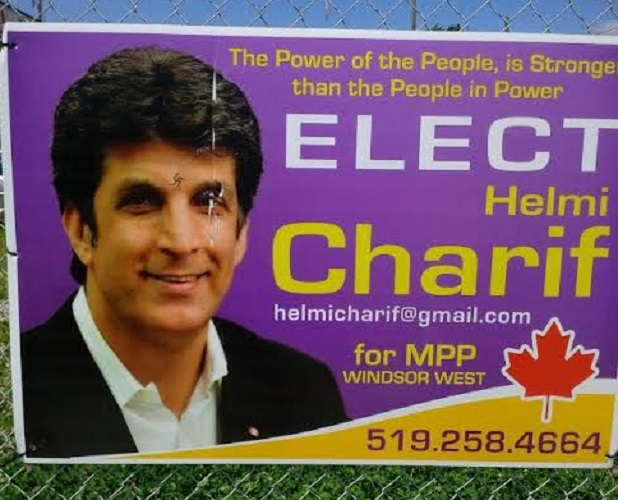 Sign of independent candidate Helmi Charif defaced with swastika.