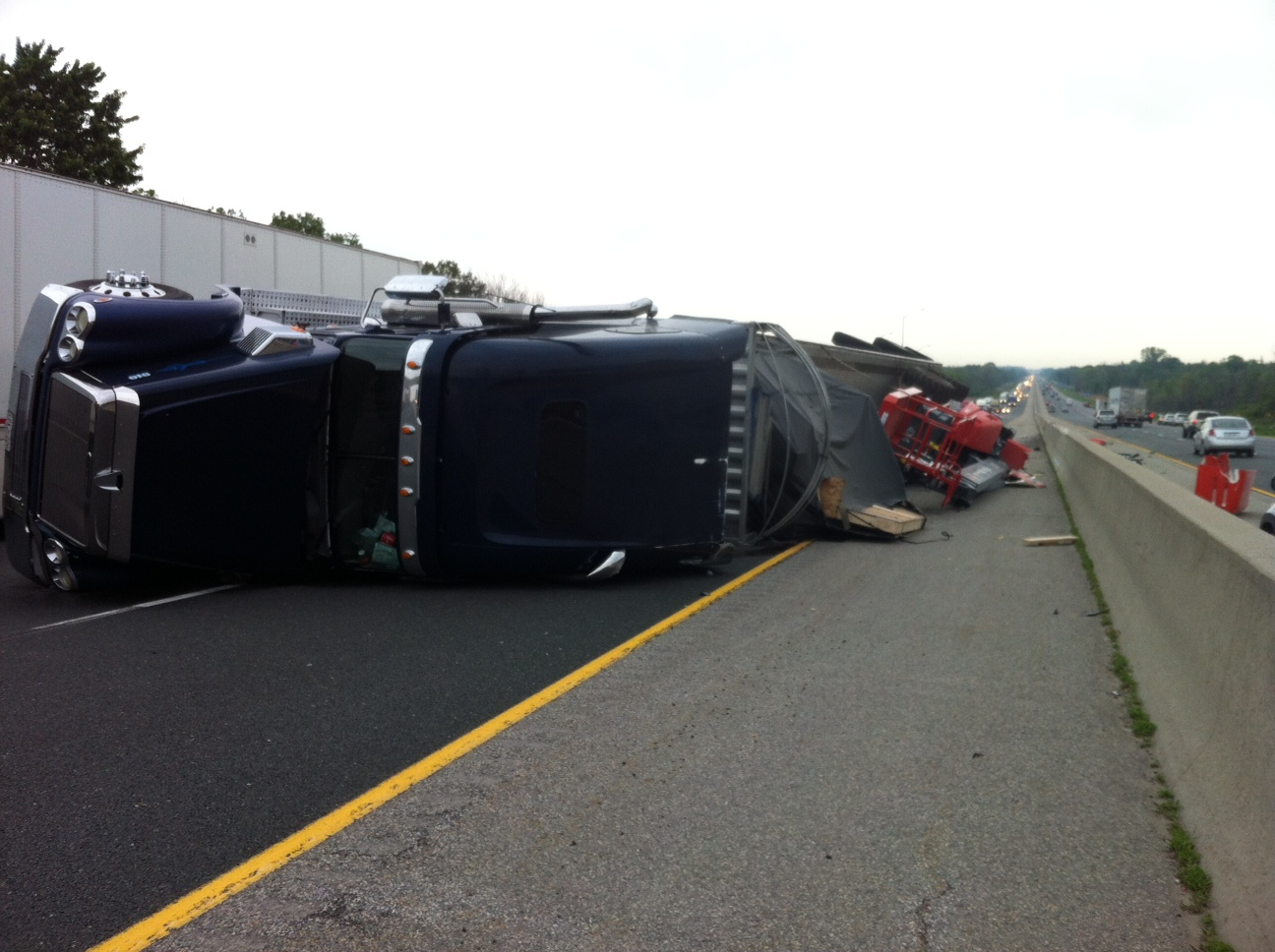 A transport truck is flipped over in the westbound lanes of Hwy, 401 near Dorchester on June 8, 2014. (Photo by Bob Becken)