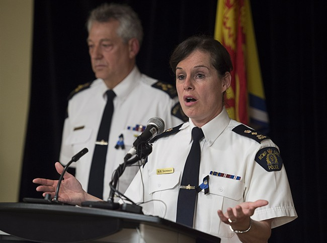 RCMP Assistant Commissioner Roger Brown, left, and Supt. Marlene Snowman provide information after police apprehended Justin Bourque, who was wanted for one of the worst mass shootings in the force's history, in Moncton, N.B. on Friday, June 6, 2014. Three RCMP officers were killed and two injured in the shooting spree. THE CANADIAN PRESS/Andrew Vaughan