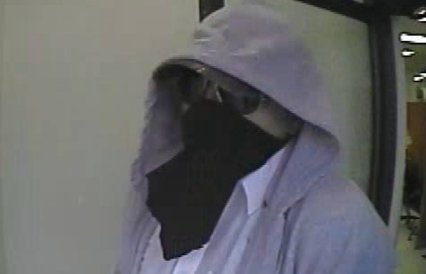 Police are looking for this suspect following an armed robbery at a CIBC bank in Petrolia, July 23, 2014. (Photo courtesy of Lambton County Ontario Provincial Police)