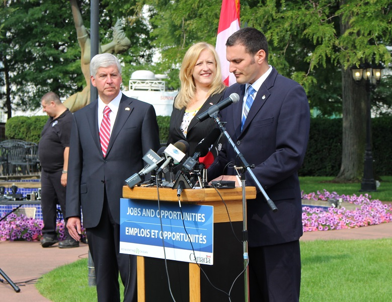 Michigan Governor Rick Snyder, Canadian Minister of transport Lisa Raitt and Essex MP Jeff Watson at the latest border announcement, July 30, 2014. (Photo by Maureen Revait)