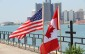 U.S. and Canadian flags along Windsor's riverfront. (Photo by Melanie Borrelli.)