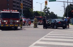 Firefighters clean up after a two-vehicle crash at Richmond and Oxford