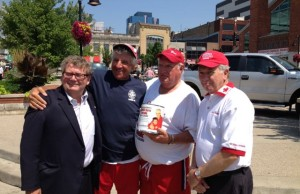 Grandpa Bob Facca with MP Ed Holder, John Davidson of Jesse's Journey and a volunteer.