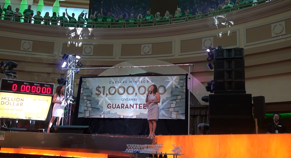 Mary Riley (right) reveals Caesars Windsor's $1-million dollar giveaway. July 28 2014. (Photo by Trevor Thompson)