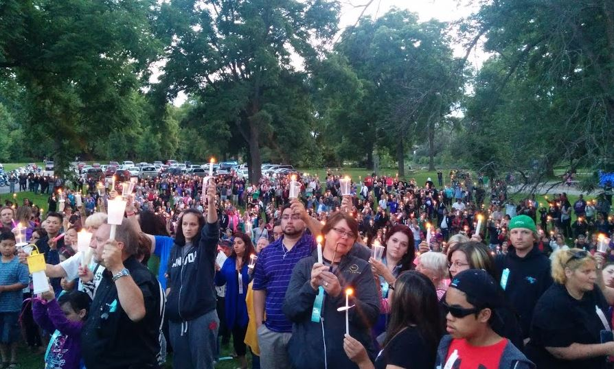 A candlelight vigil is held at Greenway Park for 6-year-old Addison Hall on July 30, 2014. (Photo by Tom Fraser)