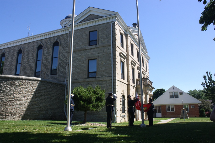 Flags are lowered outside the Chatham Jail at the closing ceremony, July 4, 2014. (Photo by Maureen Revait)