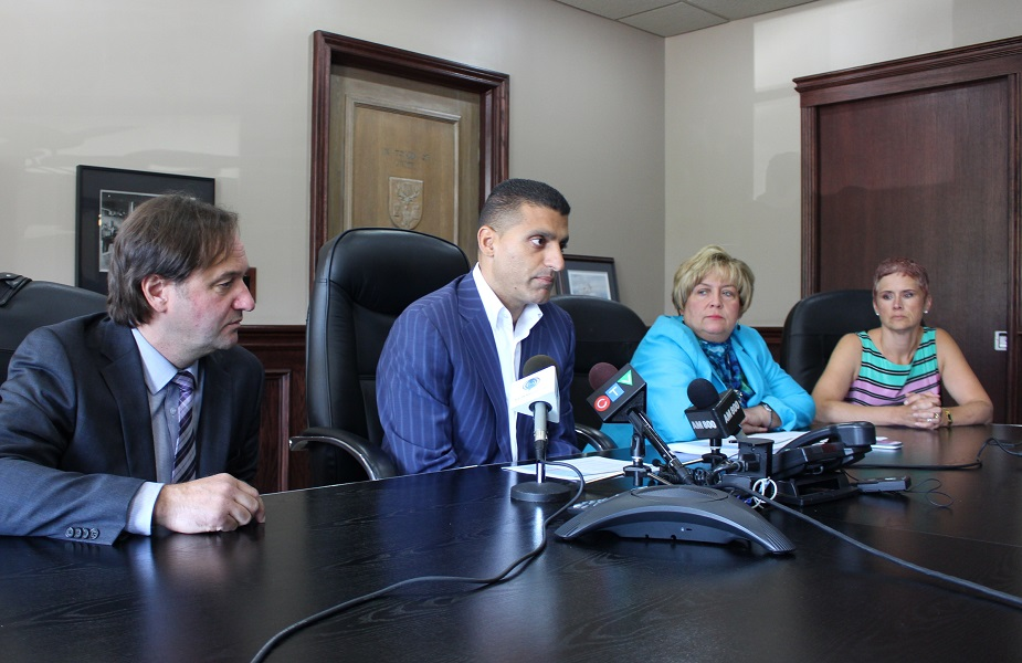 City Planner Thom Hunt, Mayor Eddie Francis, CAO Helga Reidel and City clerk Valerie Critchley at a news conference announcing organizational changes within the City of Windsor organization, July 9, 2014. (Photo by Maureen Revait)