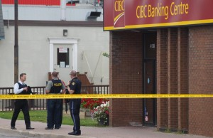 Police officers outside the Petrolia CIBC bank branch robbed at gunpoint July 23, 2014 (BlackburnNews.com photo by Jake Jeffrey)