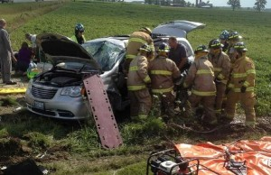 Emergency crews respond to a two-vehicle crash at tge intersection of Perth County Rd. 121 and Perth Line 67, near Milverton, July 31, 2014. (Photo courtesy of William R. Hunter ‏via Twitter)