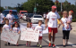 Bob Facca walking with children. July 27 2014. (Photo courtesy of Lisa Facca via twitter.)