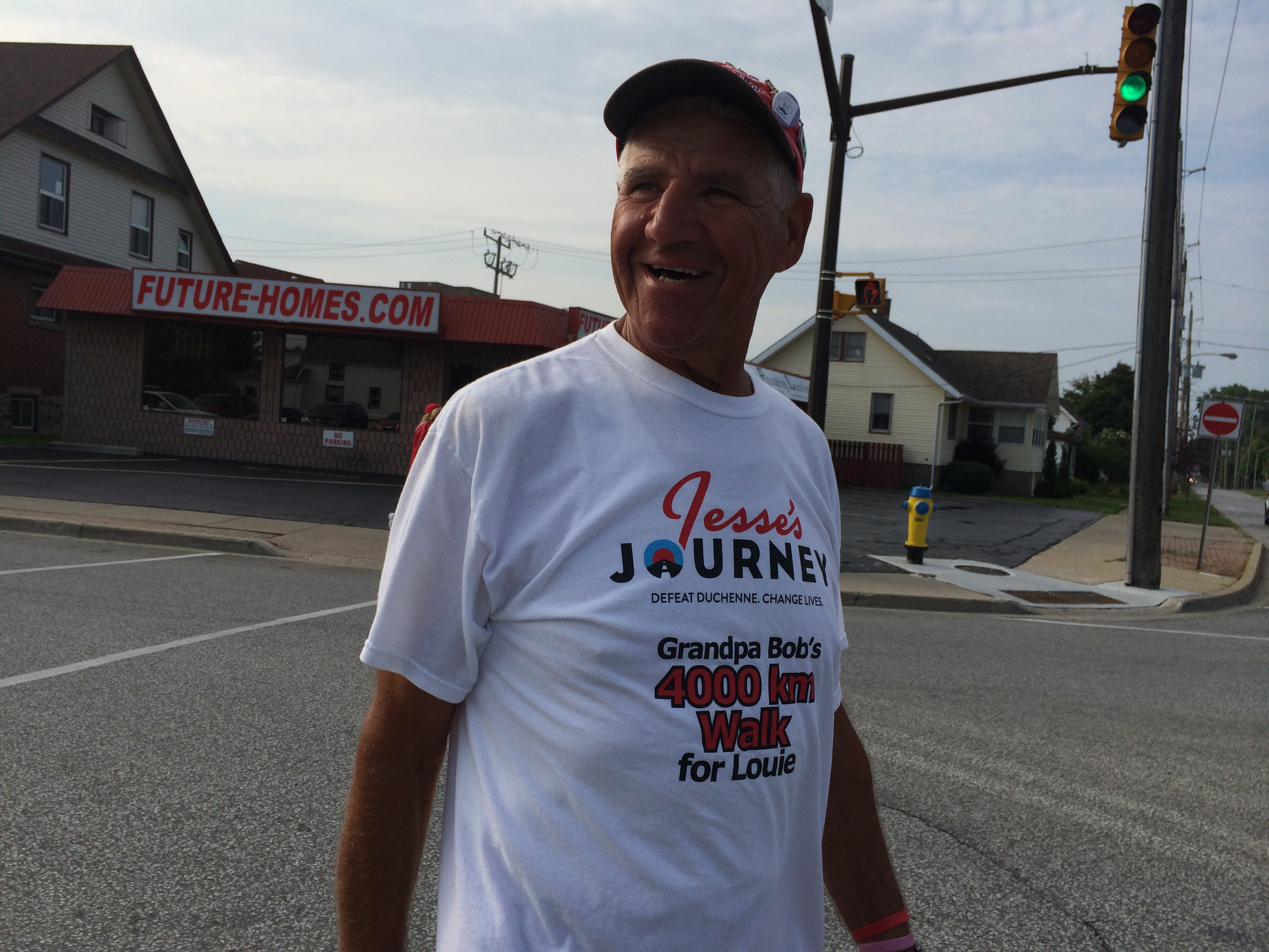 Bob Facca from London walks in uptown Leamington on July 30, 2014 as part of the Jessey's Journey initiative to raise money and awareness for Duchenne Muscular Dystrophy. (Photo by Ricardo Veneza)
